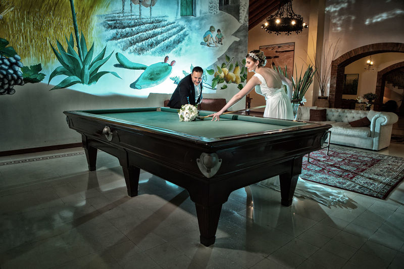 Adult Casual Clothing Couple - Relationship Females Full Length Heterosexual Couple Indoors  Leisure Activity Lifestyles Men People Playing Pool Table Real People Table Two People Women Young Adult Young Men Young Women