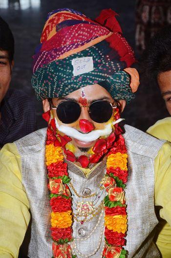 Close-Up Portrait Of Bridegroom Wearing Sunglasses During Wedding Ceremony