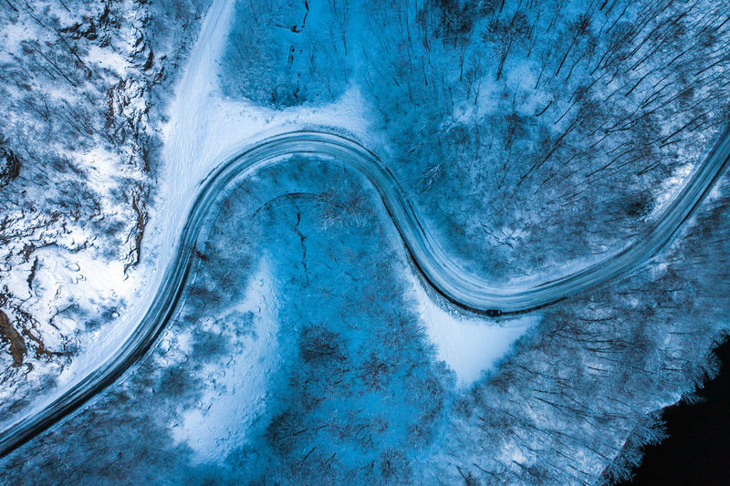 Dark winter road in the forest during blue hour. Aerial drone view Nature Scenics - Nature Landscape Beauty In Nature Outdoors Blue Hour Sunset Road Travel Blue Hour Landscape Drone  Dronephotography Drone Photography Droneshot Aerial View Aerial Aerial Photography Aerial Shot Aerial Landscape Winter Snow Road Trip Journey Wintertime Darkness
