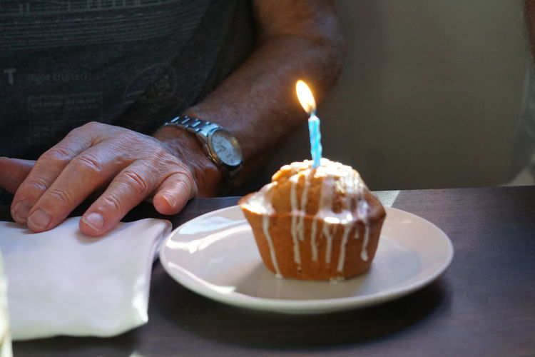 Birthday cake Human Hand Elderly Man Close-up Focus On Background EyeEm Selects Human Hand Dessert Flame Celebration Table Plate Life Events Tradition Close-up Sweet Food Birthday Cake Birthday Candles Cake Chocolate Cake Bonfire Candlelight Birthday Candle Lit