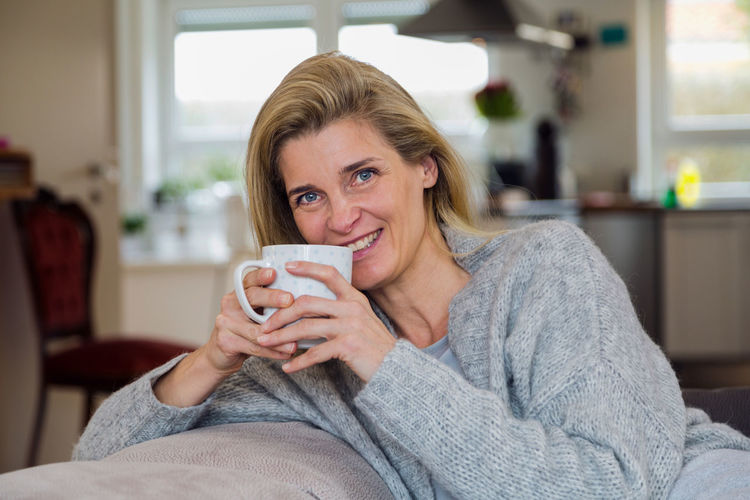 Portrait Of Happy Woman Having Coffee At Home