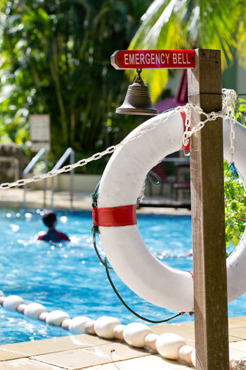 Emergency Bell Close-up Day Emergency Equipment Focus On Foreground Help Life Buoy Life Saving Nature Outdoors Red Swimming Pool Water