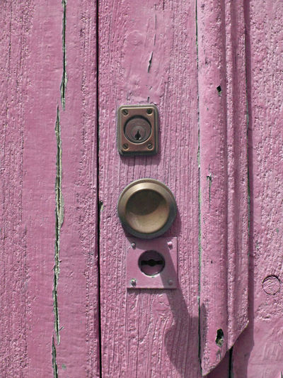 Close-up Closed Door Cracks Door Door Handle Door Knob Flaking Paint Lock Millennial Pink Old Door Outdoors Pink Color Sunshine Wood - Material