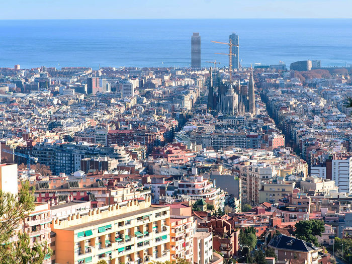 Barcelona, spain view from above picturesque sunset Building Exterior Architecture Built Structure City Cityscape Building Crowd Residential District Sky Crowded Nature Skyscraper Sea Tower High Angle View Office Building Exterior Horizon Horizon Over Water Tall - High Outdoors Community Modern Barcelona Architecture View From Above