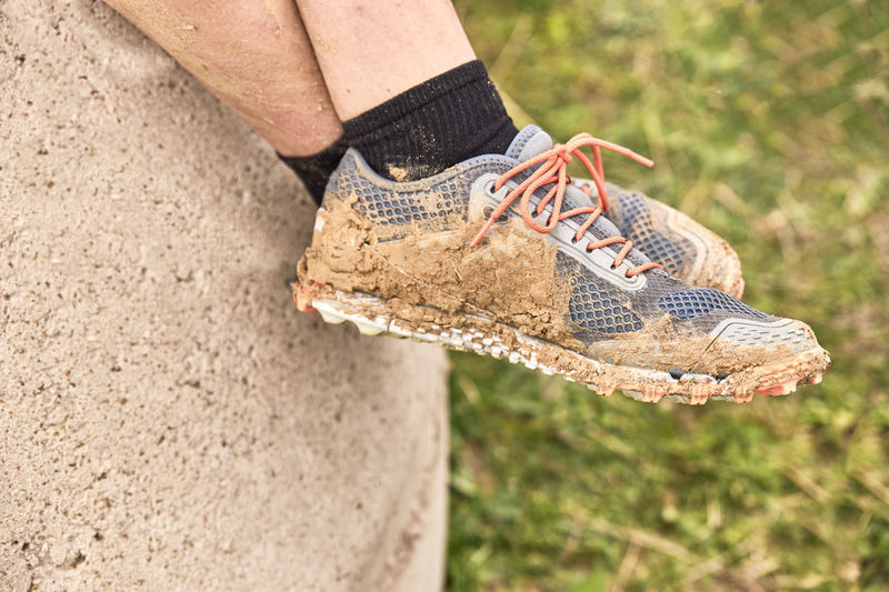 Slippers filled with mud after a spartan race - extreme sports concept