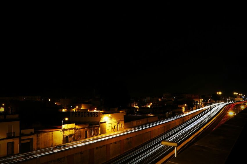 Night Illuminated Transportation City Architecture Bridge - Man Made Structure Car Built Structure Speed Cityscape High Angle View Outdoors Light Trail Road Mode Of Transport City Life Vehicle Light Street Light Travel Destinations No People