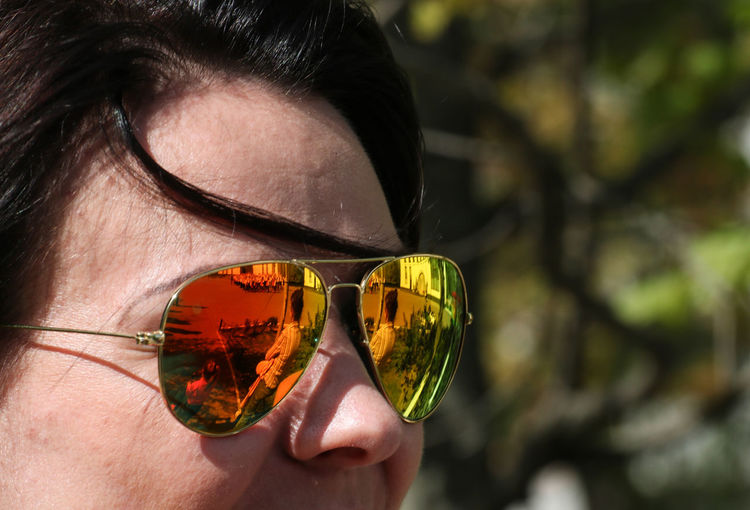 Reflection Protection Real People Security Portrait Glasses Sunglasses Outdoors Headshot Eyewear Close-up Young Adult Body Part Human Face One Person Leisure Activity Focus On Foreground Human Body Part Personal Accessory The Art Of Street Photography