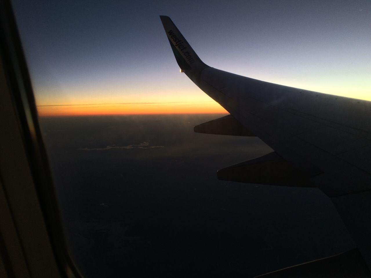airplane, transportation, journey, air vehicle, sky, mode of transport, travel, sunset, airplane wing, aircraft wing, flying, nature, no people, aerial view, beauty in nature, cloud - sky, scenics, outdoors, sea, water, day, close-up