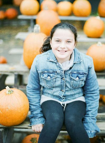 Portrait of smiling boy with pumpkins