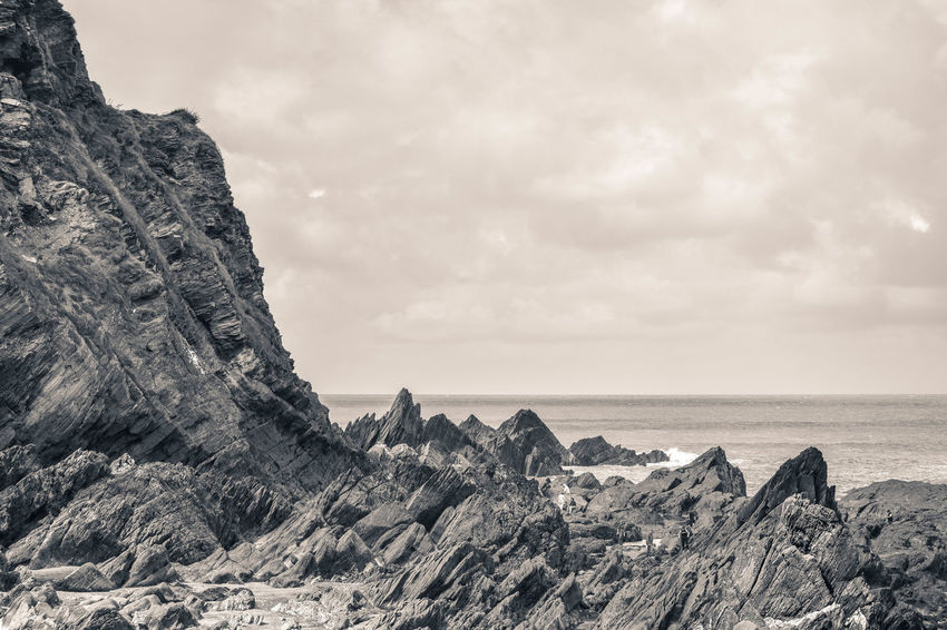 Black & White Coastline Rock Beauty In Nature Black And White Black And White Friday Cliff Day Dramatic Landscape Horizon Over Water Landscape Nature No People Outdoors Physical Geography Rock - Object Rock Formation Scenics Sea Sky Texture Tranquil Scene Tranquility Water