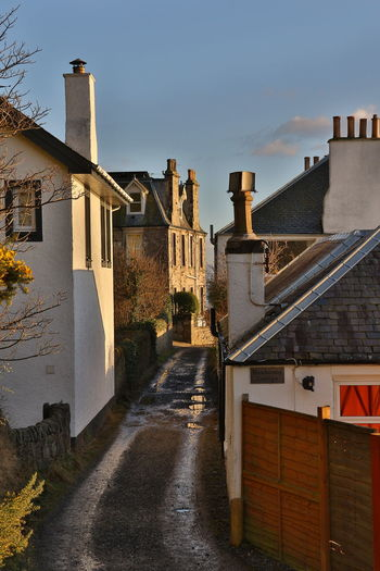 Shady Lane Fife  Fife Scotland Travel Scotland Scottish Road Trip Avenue View Golden Hour Travel Photography Travel Destinations Sundown Beautiful Lane Alley Alleyway Architecture_collection EyeEm Selects Architecture Building Exterior Built Structure Outdoors Sky City No People Day