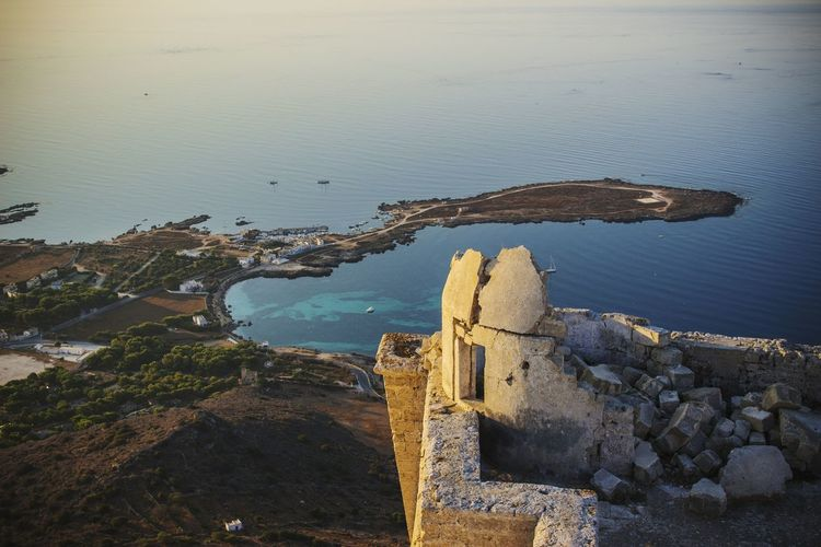 High angle view of old ruins by sea