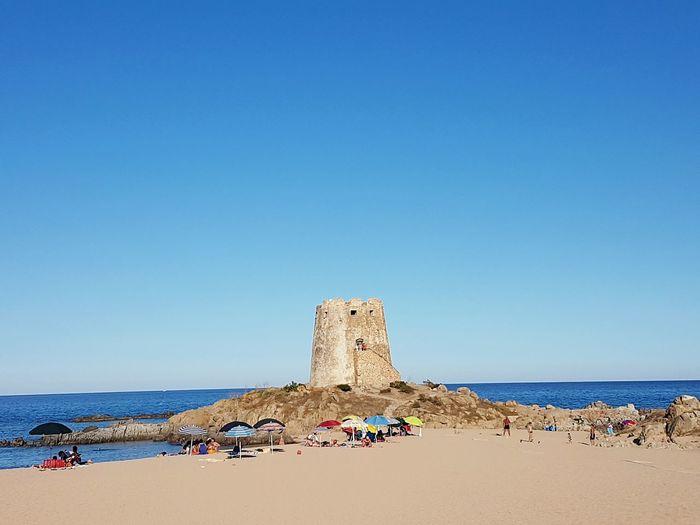 Castle at beach against clear sky