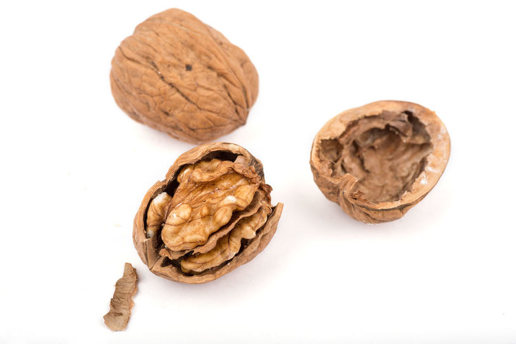 Cracked walnut on a white background. Antioxidant Food Cholesterol Lowering Close-up Cracked Nuts Dried Fruit Food Food And Drink Healthy Eating Healthy Living Better Life Healthy Snack No People Nut - Food Nut Shell Nutshell Omega 3 Peanut - Food Reduced Risk Of Heart Attack Serums Sharp Focus Studio Shot Superfood Walnut Walnuts In Center Walnuts Shell White Background