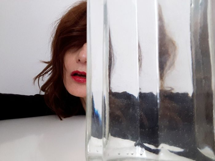 red lips Portrait Of A Woman Glass Art Glass Water Personal Perspective Young Women Human Lips Beauty Human Face Beautiful Woman Window Looking Through Window Red Lipstick Women City Lipstick Transparent Windshield Glass - Material Floating In Water