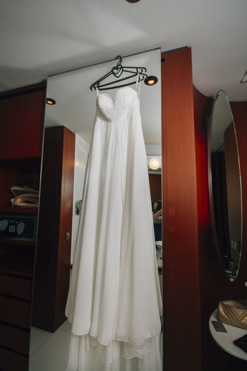 Wedding dress hanging on mirror