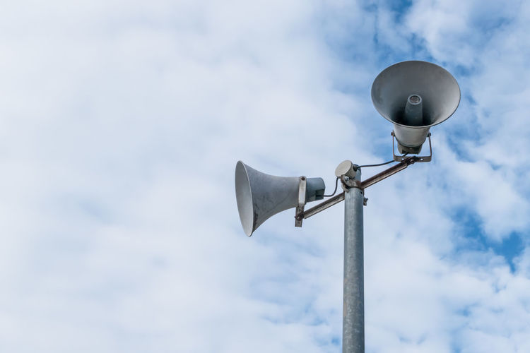 Low angle view of megaphones against sky