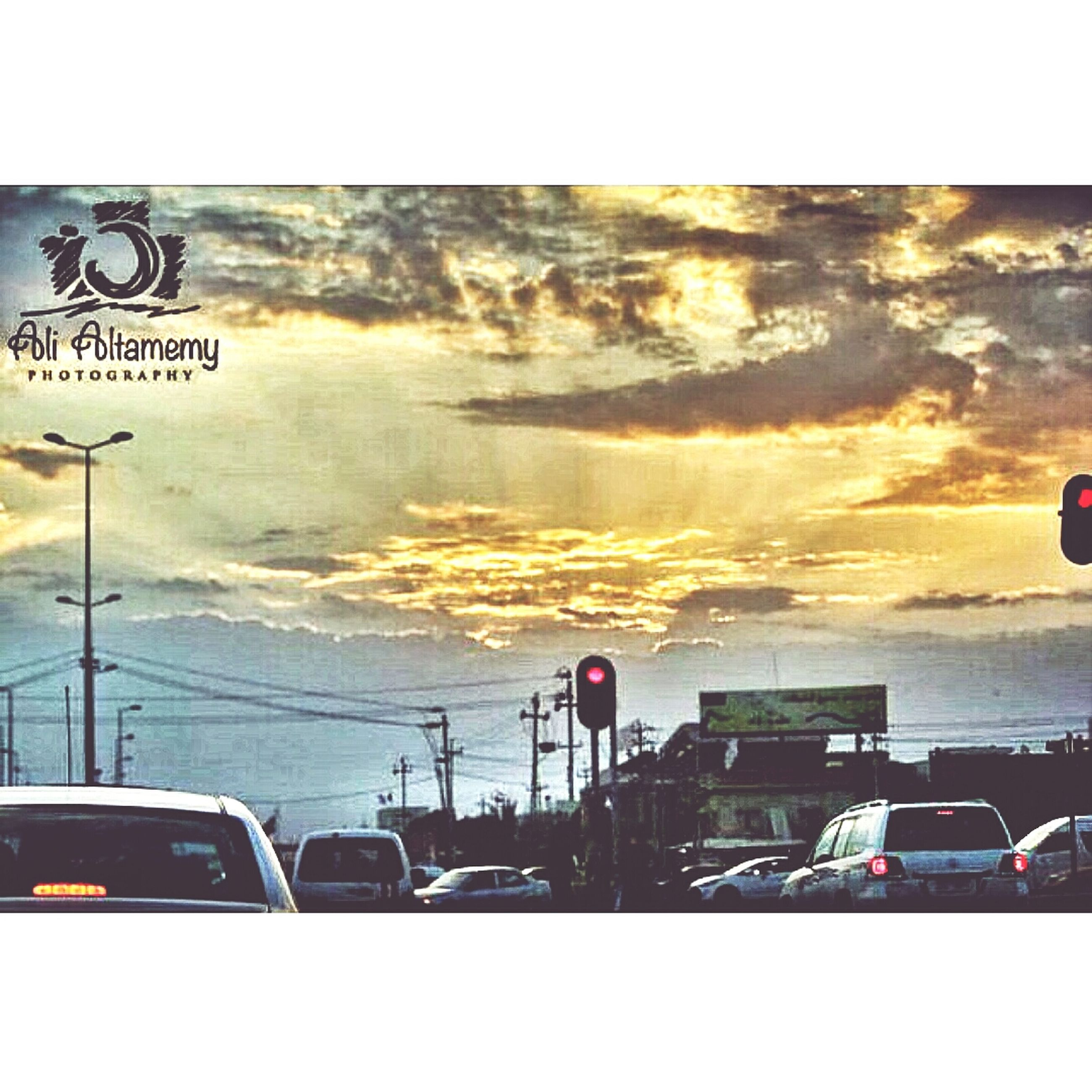 transportation, mode of transport, land vehicle, car, text, transfer print, western script, communication, sky, road sign, auto post production filter, information sign, sunset, road, street, travel, guidance, sign, on the move, cloud - sky