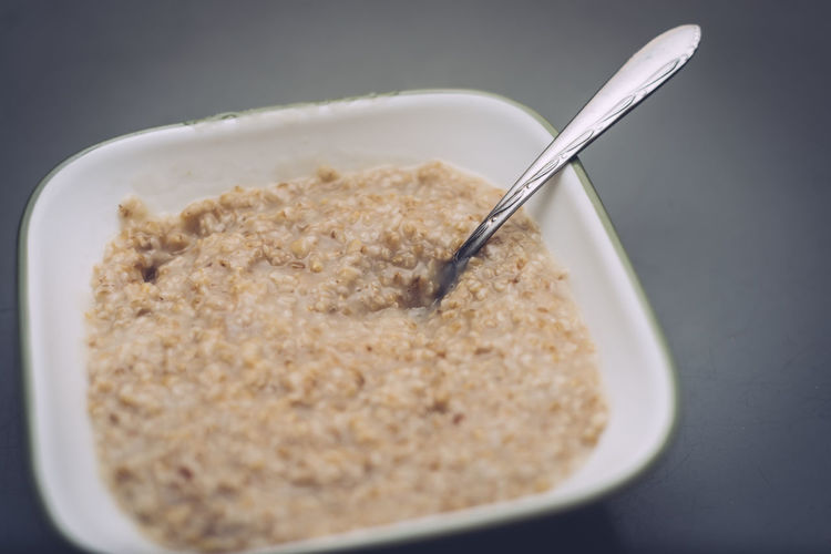 Food And Drink Spoon Food Eating Utensil Kitchen Utensil Meal Breakfast Healthy Eating Bowl Breakfast Cereal Wellbeing Freshness Close-up Indoors  No People Still Life Oatmeal Porridge Porridge