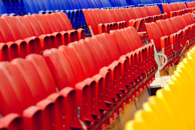 Close-up of empty seats in stadium