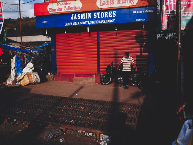 India Munnar Munnar India Munnar Kerala Munnar Top Station Red Shoes Building Exterior Closed Shop India Street Indian Man Waiting Kerala Kerala India Man Waiting Outdoors Red Shopfront Red Store Shopfront Street Photography Street Photography India Street Scenes Of India