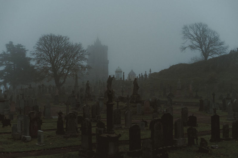View of cemetery against sky during foggy weather