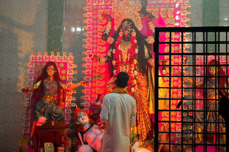Worship Traditional Festival Place Of Worship Diwali God Playing Single Man Worship Religion Spirituality Tradition Indoors  Rear View Celebration Illuminated Architecture Women Real People Night Building Exterior People Adult Adults Only