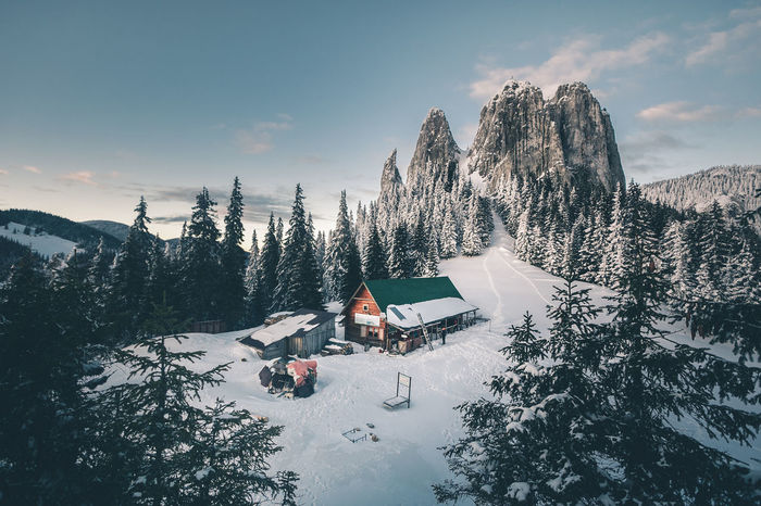 Architecture Beauty In Nature Building Building Exterior Built Structure Cloud - Sky Cold Temperature House Mountain Mountain Range Nature Non-urban Scene Outdoors Plant Scenics - Nature Sky Snow Snowcapped Mountain Tranquil Scene Tree Winter