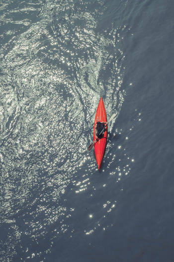 Directly Above Shot Of Man Canoeing In Sea