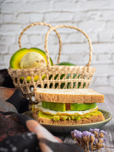 Close-up of cake in basket on table