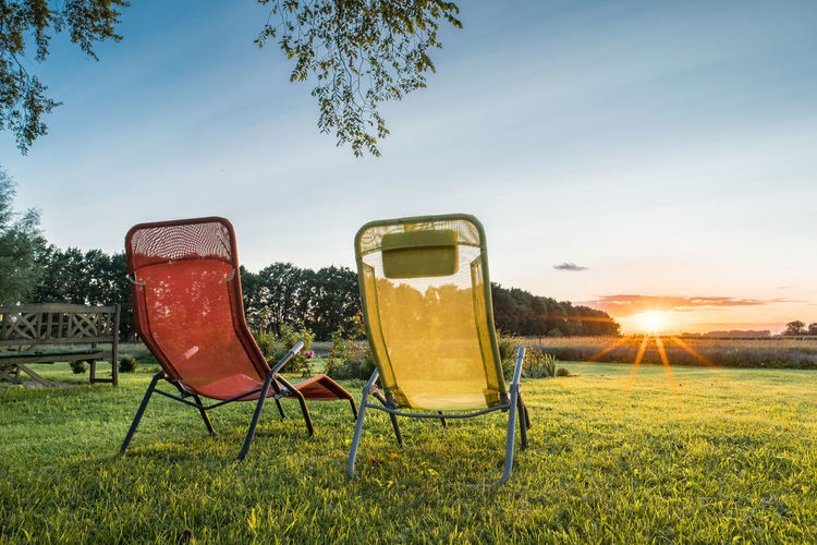 Abendstimmung Abendrot Beauty In Nature Chair Day Field Folding Chair Grass Landscape Nature No People Outdoors Sky Sunlight Sunset