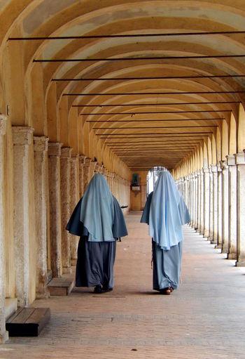 Rear view of nuns in corridor