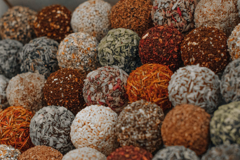 Assorted handmade truffle chocolates candies made from organic ingredients. raw food diet concept.