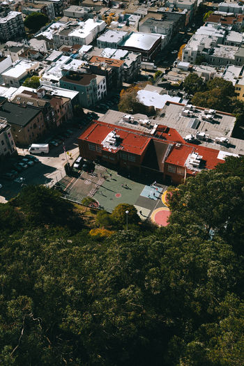 Aerial view of townscape and trees in city