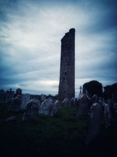 Tullaherin Round Tower, monastic site in Kilkenny dating from the early 9th century. History Tower Roundtower Monastic Monastic Building Dramatic Sky Architecture Cloud - Sky Sky Building Exterior Travel Destinations Built Structure Outdoors Cemetery Graveyard Collection Ireland🍀 Huawei P10 Plus EyeEmNewHere Graveyard Scary Places Scary Photos Scary Sky Halloween EyeEm Halloween Dramatic Photo