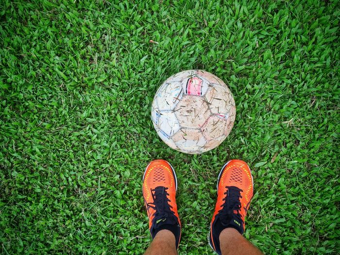 Grass Low Section Shoe High Angle View Green Color Human Leg Personal Perspective Standing One Person Day Human Body Part Field Lawn Directly Above Outdoors Grass Area Real People Golf Game People Sport Soccer Player Football Background