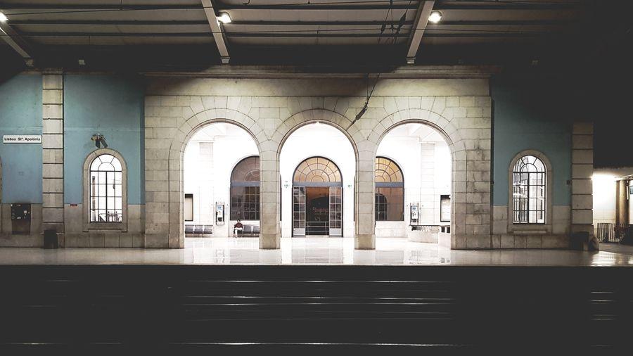 Interior of illuminated railroad station building