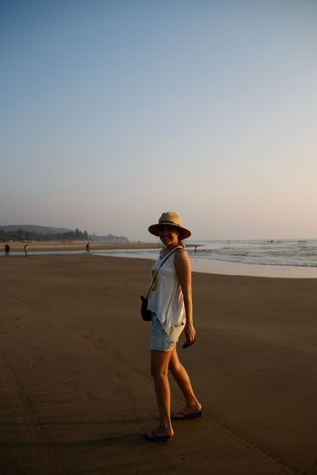 Beach Beach Life Beach Photography Full Length Goa Horizon Over Water India Nature North Goa Ocean One Person One Woman Only Only Women Outdoors Sand Sea Smiling Summer Sunhat Sunset Tourism Travel Vacations Walking On The Beach Water Women Around The World