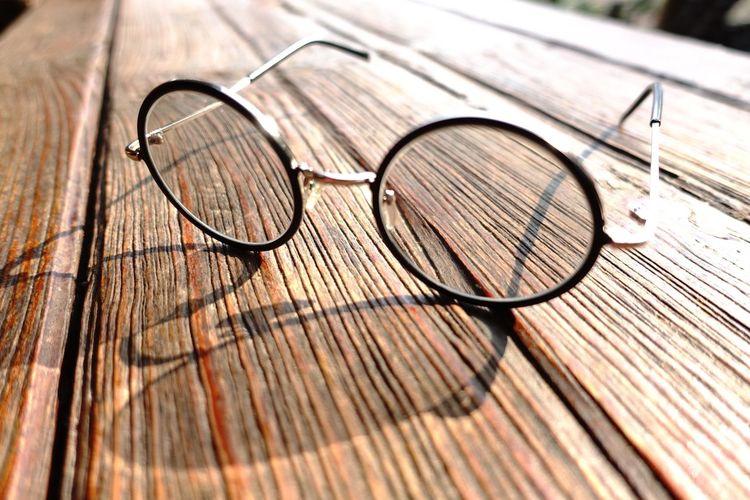 High angle view of eyeglasses on wood