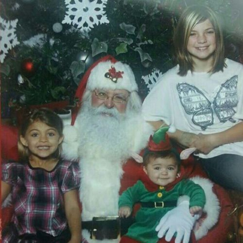My neices. Little Sophia dressed as an elf. Looks like she belongs in the Santaclause movies.