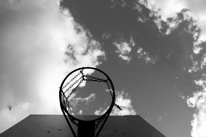 Black and white image of a basketball hoop on cloudy sky, retro concept Basketball Hoop Sky Blue Sport Outdoor Vintage Retro Old Game Equipment Play Basket Court Goal Competition Ring Street Activity Sports Outside Playground Blue Sky Sports Equipment Cloudy Stadium Horizontal Basketball - Sport Basketball Net  Copyspace negative space Basketball Hoop Basketball Hoops Aim Daytime Facility Hoops Silhouette Pastime Basketball Background Looking Up Day Light Atmosphere Lifestyle Urban Beautiful Ghetto Web College Sports Gear Copy Space Cloudscape Cloud - Sky Outdoors No People