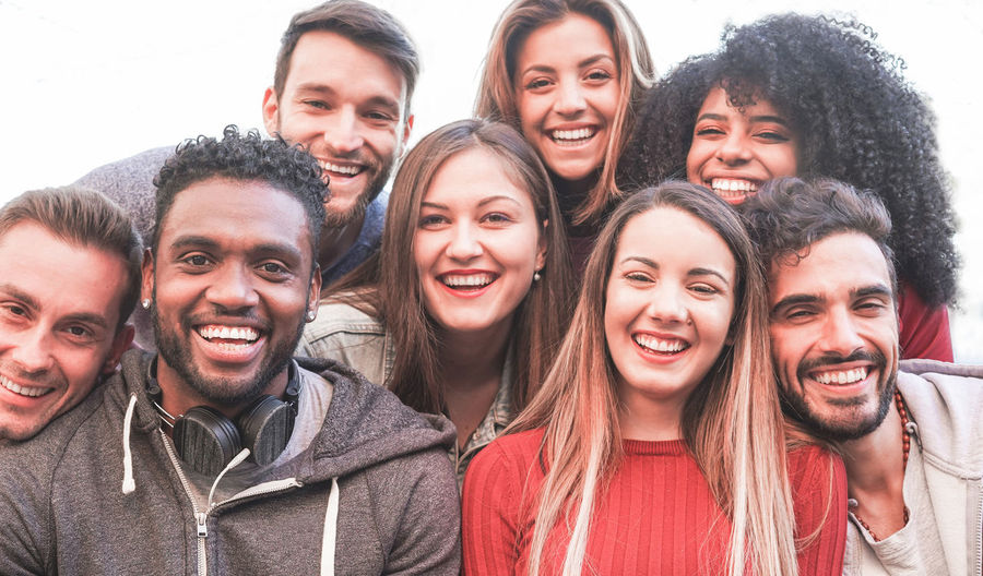 Happy millennial friends from diverse cultures and races taking selfie for social network story - Youth and friendship concept with young people having fun together - Main focus on black man face Millennials Millenials Young People Friends Party Smiling Happiness Young Adult Togetherness Group Of People Young Men Looking At Camera Friendship Young Women Lifestyles Outdoors Portrait Multiracial