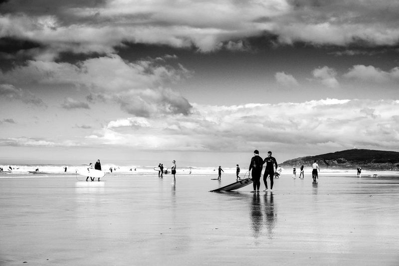 Sand Surfers Surf Beach Sky Cloud - Sky Water Sea Large Group Of People Leisure Activity Nature Beauty In Nature Horizon Over Water Day Outdoors Sport Scenics Real People Sand Lifestyles Men People