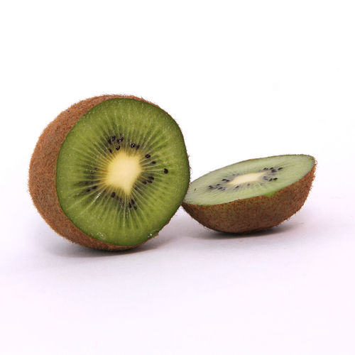 Healthy Eating Fruit Food And Drink Wellbeing Food White Background Studio Shot Kiwi Cross Section Indoors  Still Life Freshness SLICE Green Color No People Kiwi - Fruit Close-up Halved Cut Out Copy Space Ripe