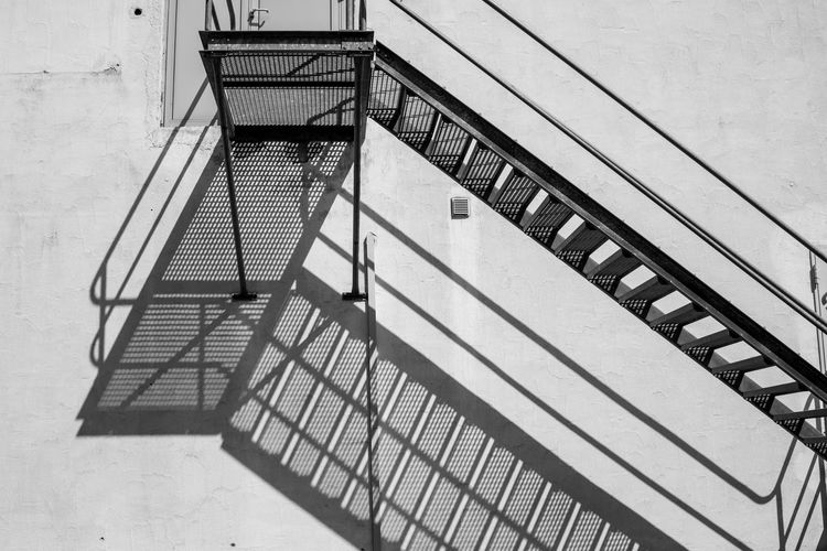 Shadow on the wall Architecture Staircase Built Structure Railing Steps And Staircases No People High Angle View Day Metal Nature Fire Escape Building Exterior Shadow Outdoors Sunlight Building Safety Security Absence Wall