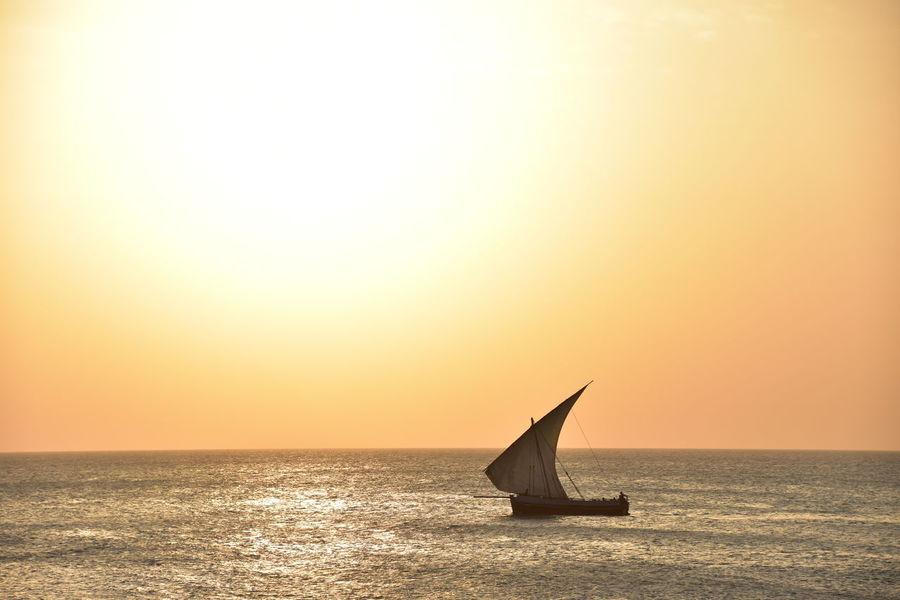 43 Golden Moments Africa Beauty In Nature Boat Mode Of Transport Nautical Vessel Sea Seascape Sun Tanzania Water Zanzibar