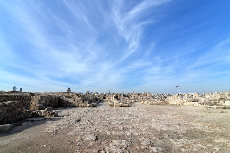 Old ruins at amman citadel against sky