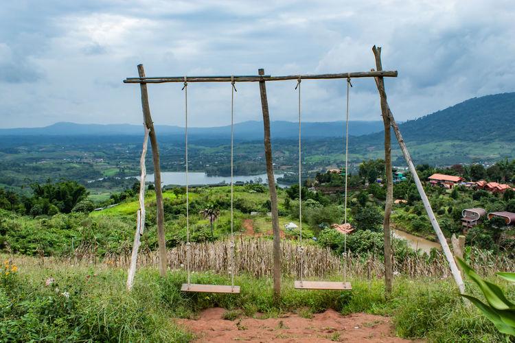 Swings hanging against landscape