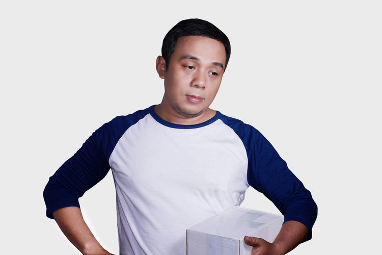 Portrait of disapointed asian man expression Asian  Casual Clothing Disapointed Emotion Expression Lifestyles One Person Portrait Standing
