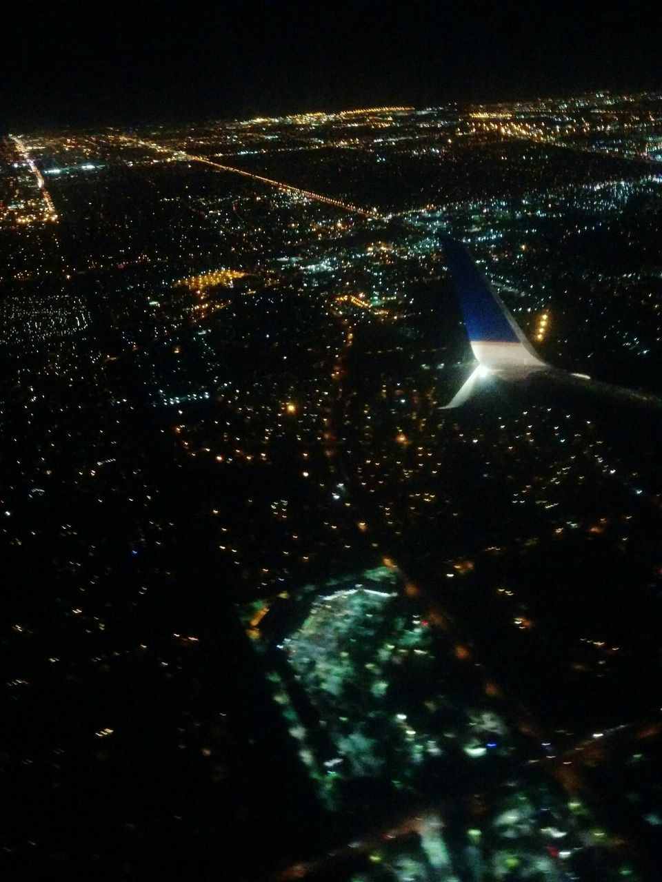 night, illuminated, no people, aerial view, city, outdoors, cityscape, nature, airplane wing